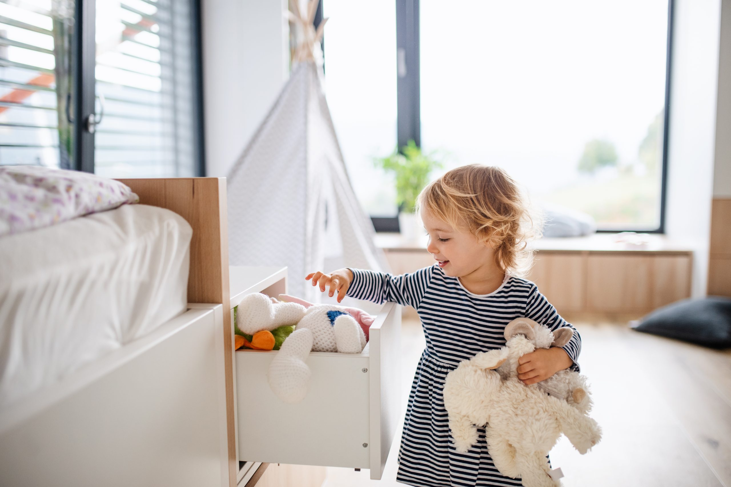 child-playing-in-bedroom